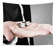 A Male Model Showcasing Cuff Links In His Hand Tapestry
