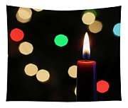 A Red Christmas Candle With Blurred Lights Tapestry