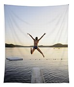 A Swimmer Jumps Off A Diving Board Tapestry