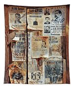 A Wooden Frame Full Of Wanted Posters Tapestry