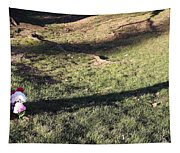 An Arlington Grave With Flowers And Shadows Tapestry