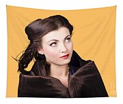 Beautiful Winter Woman Isolated On Orange Tapestry