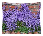 Brick Wall With Blue Flowers Tapestry