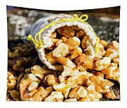 Closeup Of Walnuts Spilling From Small Bag Tapestry
