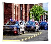 Line Of Police Cars Tapestry