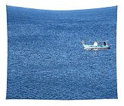 Lonely Fishing Boat Sailing On A Calm Blue Sea Tapestry