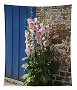 Pink Hollyhocks Growing From A Crack In The Pavement Tapestry