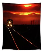 Scenic View Of An Approaching Trrain Near Sunset Tapestry