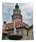The Cesky Krumlov Castle Tower With A Fountain Below Within The Czech Republic Tapestry