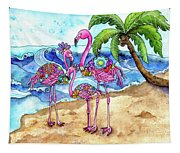 The Flamingo Family's Day At The Beach Tapestry