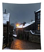 The Village Of Heptonstall In The Snow At Night With Lamps Shini Tapestry