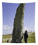 Tourist Admires The Trushal Stone Tapestry