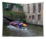 Tourists With Umbrellas In A Sightseeing Boat On The Canal In Bruges Tapestry