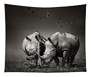 Two Rhinoceros With Birds In Bw Tapestry