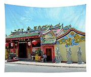 Woman Sits Outside Chinese Temple With Urn And Deity Statues Pattani Thailand Tapestry