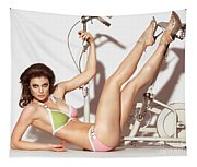 Young Woman In A Swimsuit Posing With Exercise Bike Tapestry