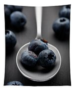 blueberries and a silver spoon on distressed wood No. 2 Tapestry