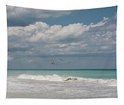 Group Of Pelicans Above The Ocean Tapestry