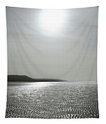 Low Tide Sandy Beach Ripples Silhouetted Against Sun Tapestry