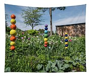 Sticks With Colorful Balls In A Garden Tapestry