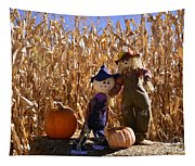Two Cute Scarecrows With Pumpkins In The Dry Corn Field Tapestry