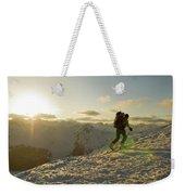 A Man Backcountry Skiing At Sunset Weekender Tote Bag