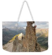 A Man Tops Out A Spire On Treasure Weekender Tote Bag
