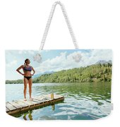 A Woman Is Standing On A Jetty Weekender Tote Bag