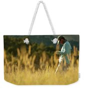 A Young Man Fly-fishing At Sunset Weekender Tote Bag