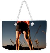 A Young Woman Runs Through A Grassy Weekender Tote Bag