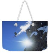 An Extreme Skier Jumps Off A Snowy Weekender Tote Bag