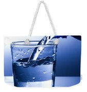 Pouring Fresh Water Into A Glass Weekender Tote Bag