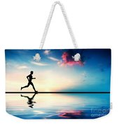 Silhouette Of Man Running At Sunset Weekender Tote Bag by Michal Bednarek