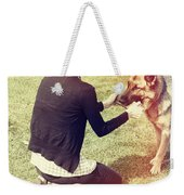 Young Woman In 20s Playing Fetch With Her Dog Weekender Tote Bag
