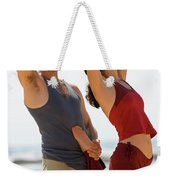 A Man And Woman Practicing Yoga Weekender Tote Bag