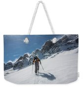 A Man Ski Touring In The Mountains Weekender Tote Bag