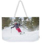 A Skier Descends A Snowy Slope Weekender Tote Bag