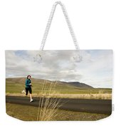 A Woman Out For A Jog In The Country Weekender Tote Bag