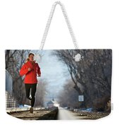 A Woman Running Near A Railroad Track Weekender Tote Bag