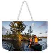 A Young Couple Paddles A Canoe On Long Weekender Tote Bag