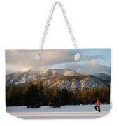 A Young Woman Snowshoes Through Freshly Weekender Tote Bag