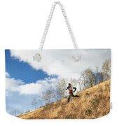 An Adult Male Trail Running Weekender Tote Bag