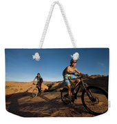 Couple Mountain Biking, Moab, Utah Weekender Tote Bag