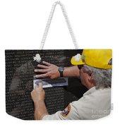 Man Getting A Rubbing Of Fallen Soldier's Name At The Vietnam War Memorial Weekender Tote Bag