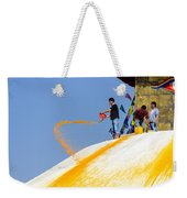 Man Throwing Orange Paint On Boudhanath Stupa Weekender Tote Bag