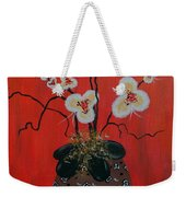 Orchids In A Pot On Orange Weekender Tote Bag