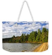Red Canoe On Lake Shore Weekender Tote Bag by Elena Elisseeva