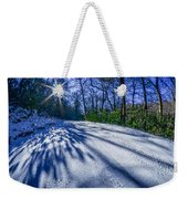 Snow Covered Road Leads Through The Wooded Forest Weekender Tote Bag