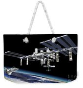 Space Station In Orbit Around Earth Weekender Tote Bag by Leonello Calvetti
