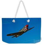 A Curtiss P-40e Warhawk In Flight Weekender Tote Bag